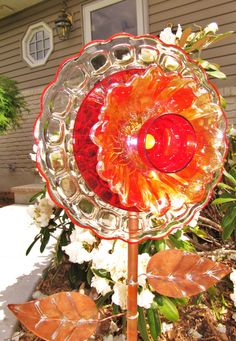 WHAT IS A PLATE FLOWER?  They are garden art creations, made of vintage glass items. I love to repurposed lovely vintage glass, because there is