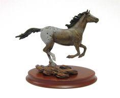 Lot 1049 - A `FRANKLIN MINT` CAST FIGURE OF AN APPALOOSA HORSE `Thunder on the Prairie` by Chuck DeHaan, on