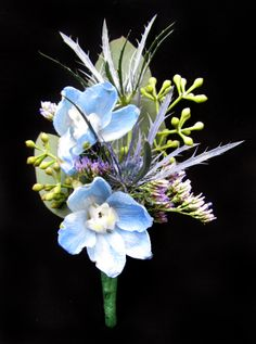 boutonniere of light blue delphinium, blue thistle, seeded eucalyptus, and limonium Prom Flowers, May Flowers, Types Of Flowers, Colorful Flowers, Paper Flowers, Wedding Flowers, Blue Boutonniere, Prom Corsage And Boutonniere, Boutonnieres