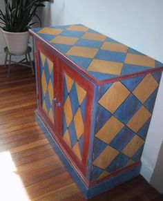 Harlequin pattern painted cupboard