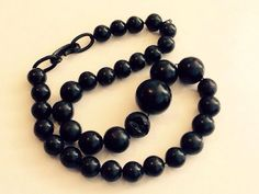Victorian vulcanite bead necklace with damaged bead.