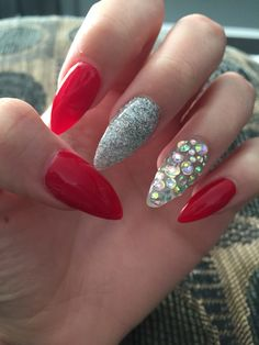 red sparkly almond shape nails