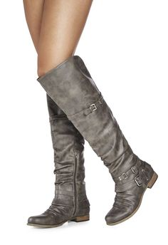 Get into gear for fall with a pair of over-the-knee boots you won't be able to resist wearing all season. Catlia features ankle strap detailing, and a low block heel. Faux leather....