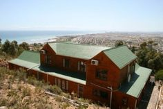 OH MAN, WHAT A VIEW: This family home situated against the mountainside offers spectacular views of False Bay and the mountain. With the nature reserve as your back garden you cannot get closer to nature. The house boasts 4 bedrooms, 2 bathroom, lovely living areas and an special entertainment room with an indoor pool. The home also has excellent security and much, much more