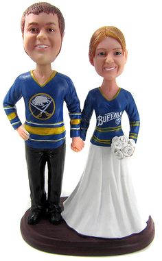 Custom cake toppers are perfect for all hockey lovers - even if you root for different teams!  Along with your faces, we can customize the jerseys to match your favorite team with color, logo, numbers and even your name!