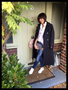 Military coat dressed down with a tailored white shirt & trainers www.mymidlifefashion.com