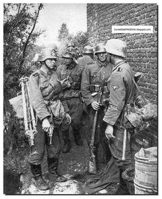 A Waffen SS division as it moves into France in 1940. The Pictures are by German war photographer Friedrich Zschäckel