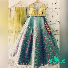Teal Floral Lines Lehenga . Stunning designer lehenga with bird on hanging chandelier design hand embroidery classy thread work. Lime yellow color designer blouse with hand embroidery work. Indian Wedding Outfits, Bridal Outfits, Indian Outfits, Indian Designer Outfits, Designer Dresses, Designer Clothing, Anarkali, Lehenga Choli, Sabyasachi