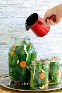 Photo about Woman hand making pickled cucumbers in a glass jars. Image of country, autumn, jars - 97977689 Canning Pickles, European Cuisine, Homemade Pickles, Pickling Cucumbers, Romanian Food, Romanian Recipes, Home Food, Canning Recipes, Diy Food