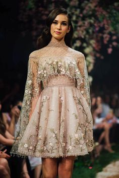 """""""Once Upon a Dream"""" – a fairytale collaboration between Paolo Sebastian and Disney, is a magical, mesmerizing 34-piece collection inspired by Disney princesses Cinderella, Sleeping Beauty, Belle, and more. Gowns of French tulle and silk chiffon in soft pastel hues, glittering with hand-sewn embroidery and beadwork, glided down the runway. Colour us enchanted! Keep your eye out for the Snow White-inspired gowns, perfectly timed for the film's 80th anniversary later this year."""