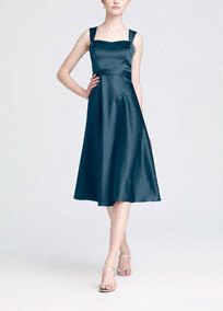 Vintage-inspired, this satin style combines modern sophistication with old hollywood glamour.   Wide strap tank bodice is supportive while sweetheart neckline is ultra feminine.  Tea-length skirt mixes flirty with flattering to create a timeless silhouette.  Lined Bodice. Back zip. Imported polyester. Dry clean only.