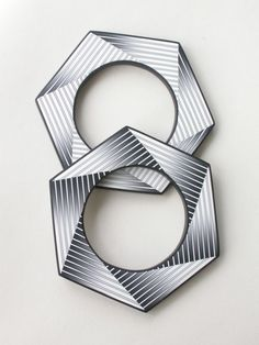 2 Hexagon bangles by Carol Blackburn, polymer clay. I just saw these in a book yesterday and thought they were line drawings! Beautiful movement.