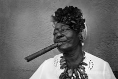 Cuban women pose for tourists while pretending to smoke a large Cuban cigar in the streets of Havana.Various Cuban women pose for tourists while pretending to smoke a large Cuban cigar in the streets of Havana. Women Smoking Cigars, Cigar Smoking, Black N White Images, Black And White, Black Art, Cuban Women, Good Cigars, Female Poses, People Of The World