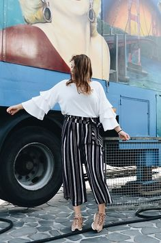 Get this look: http://lb.nu/look/8790709  More looks by Odette: http://lb.nu/odettevandijk  Items in this look:  Nike Air Max 95, Zara Culotte, River Island Shirt   #ruffles #ruches #flared #culotte #summer #streetstyle #sneakers #sneakerlover #nikeairmax