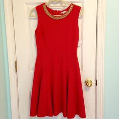 Super flattering Fit & Flare dress. Never worn!! ORANGE cocktail dress with gold beading at the neckline. Simple, classic, and flattering. Perfect fall dress! A few beads on the right side of the collar have come off but it is NOT noticeable. NWOT Sandra Darren Dresses