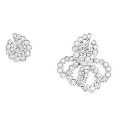 These Dior Milieu du Siècle earrings with white gold and diamonds by Dior Joaillerie are as light as lace and inspiraed by the fashion house's couture. Discover our top 5 earrings and ear climbers for a fine jewellery and fashion forward gift for women: http://www.thejewelleryeditor.com/jewellery/top-5/top-5-on-trend-earrings-christmas-gift-ideas/ #jewelry