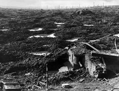Ypres, 1917. The cratered battlefield of Passchendaele where men drowned in the mud.