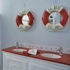 Beachy Bathroom - such a cute idea for mirrors in a small bathroom.