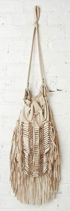 Free People Leather Bag with fringe trim & drawstring closure. Long Strap is removable. Leather is soft & supple. Dreamweaver Crossbody - By Spell and the Gypsy Collective