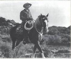 Gene Autry riding Champion.