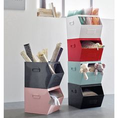 Practical and stackable, these metal storage boxes are perfect for making a feature of your tidied away clutter.
