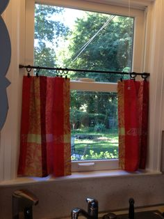 Homemade curtains using dinner napkins from home goods and curtain clips and tension rod from target!! Yay!
