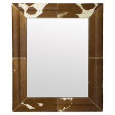 Featuring a cowhide-inspired frame, this rustic wall mirror offers ranch-chic style for your home.  Product: Wall mirror