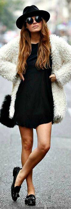 All black look with white fluffy coat and sunglasses. Retro inspired. #shopcade #streetstyle