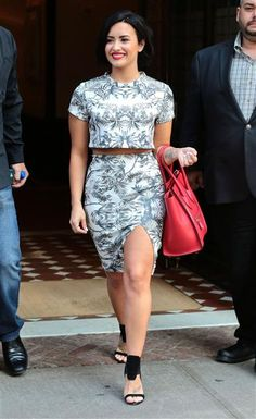 Demi Lovato: Demi looked ready for the season in a palm tree printed crop top and skirt two-piece outfit while in New York City on June 6, 2015.