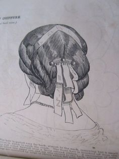May 1862 Peterson's: The hair is parted very far back, almost to the neck, reserving but a small portion in which to catch the comb. The front hair is brushed off from the face and rolled forward over a fancy colored ribbon. A succession of rolls fall below this upper one, and are also carried to the back, where the fastenings are concealed by loops of ribbon which fall from the comb.""