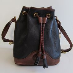 Dooney and Bourke Black and Brown Pebbled Leather Bucket Bag/ Large Drawstring Satchel Purse. $58.00, via Etsy by MothEatenDeerHead