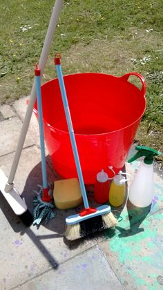 This is great for mark making and lovely outdoor play on a hot day! So simple, no clean up! Fill up a trug with water, add mops, brushes, brooms, sponges, spray bottles. Sit back while your children play. Dipping their tools in and making marks all over the garden/pavement/shed. :)