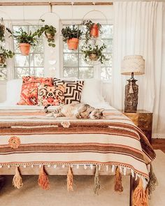 boho bedroom with orange accents