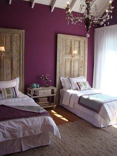 rich purple, paneled ceiling, doors-as-headboards.