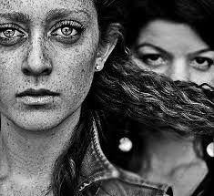Diane Arbus created this awesome picture by focusing on the main subjects freckles and glistening eyes. She also adds a mysterious and sneaky affect by including the girl in the background hiding behind the subjects hair. Diane Arbus, Street Photography, Portrait Photography, People Photography, Artistic Photography, Berenice Abbott, Black White, Famous Photographers, Interesting Faces
