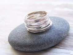 Beautiful set of thin Sterling Silver Hammered Stack Rings!   Each ring has been hand crafted by me and hammered and polished for a beautiful finish!
