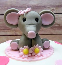 Adorable baby elephant! Can eaily be modified for a boys cake. Top tier in picture is a 6 round.