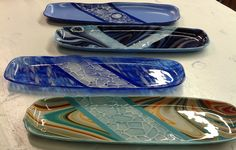 """Full fused and slumped bread platters, made by students in our Friends Night Out """"Fused Glass Bread Platter"""" workshop Fused Glass Plates, Fused Glass Art, Glass Dishes, Mosaic Glass, Glass Fusion Ideas, Stained Glass Supplies, Glass Fusing Projects, Slumped Glass, Glass Design"""