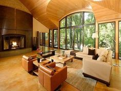 Hard to decide whether to look at the fireplace or out the beautiful wall of windows!  Aspen CO home for sale.