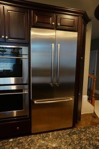 Custom Kitchen- Dark Stained Cabinets, Above-the-fridge Storage Dark Stained Cabinets, Fridge Storage, Contractors License, Custom Cabinetry, French Door Refrigerator, The Prestige, Entertainment Center, Countertops, Kitchen Appliances