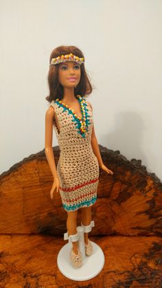 Barbie is dressed in a Indian dress with moccasins and a headdress. Beach Barbie is included in this set.