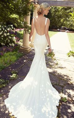 Modern wedding dresses from Essense of Australia featuring tailored, clean lines of Crepe and a flute-shaped train and sheer magic illusion ...