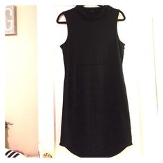 New Elie Tahari hooded dress. Size medium Brand new (tags were cut out but never been worn) black hooded Elie Tahari sleeveless dress (cute front pocket) stretchy thick cotton super soft/comfy dress. Size medium can fit a large comfortably. Super cute and versatile!!! Bought at a sample sale so there is no size tag but it's a medium! Almost midi length! Elie Tahari Dresses Midi