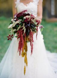 A lush wedding bouquet that is practically dripping with flowers! These dark hues are perfect for a fall wedding.