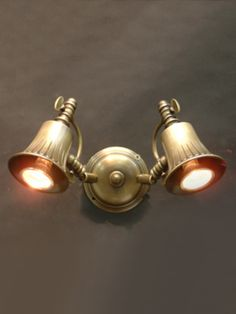 Twin spot light with adjustable heads. Available in various finishes.