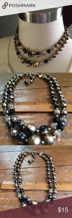 """Vintage Double Stranded Necklace Vintage black & gold tone beaded necklace.  Round black beads brushed with gold, faceted gold tone beads & tiny gold tone spacer beads.  The closure is a hook clasp signed Japan.  Approx length 12"""" 14"""" with a 2.5"""" extension Vintage Jewelry Necklaces"""
