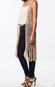 Style:  You'll be feelin groovy in this taupe hippie inspired open crochet long fringe vest.  It's your bohemian free spirit yearning to be free. Material:   60% Cotton/40% Polyester Enclosure: Open Length: 44""