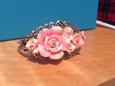 Silver filigree bangle bracelet with polymer flowers