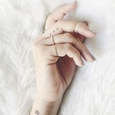Tiny finger tattoos for girls; small tattoos for women; finger tattoos with meaning; White Finger Tattoos, Finger Tattoo For Women, Finger Tattoo Designs, Tattoo Finger, Ring Finger, Finger Tats, Small Tattoos On Finger, White Ink Tattoos, Simple Finger Tattoo