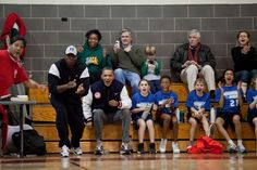 """Feb. 5, 2011 """"The two coaches for Sasha Obama's basketball team couldn't make it to one of her games, so the President and his then personal aide, Reggie Love, filled in as coaches for this game one Saturday. Here they along with Sasha's teammates react during the game."""" (Official White House Photo by Pete Souza)"""